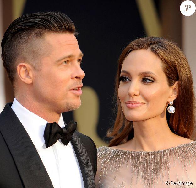 Brad Pitt et Angelina Jolie à la 86e cérémonie des Oscars à Hollywood, le 2 mars 2014.