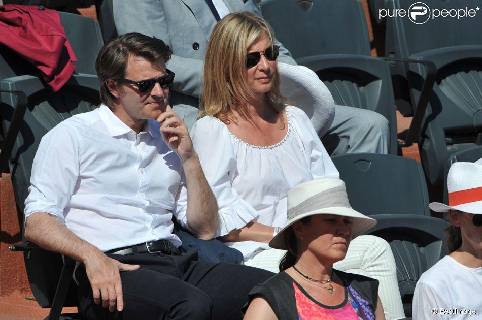 François Baroin et sa compagne Michèle Laroque à Paris, le 6 juin 2014.