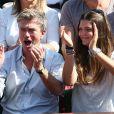 Philippe Caroit et sa fille Blanche lors de la demi-finale de la Coupe Davis entre la France et la République Tchèque le 13 septembre 2014 à Paris.