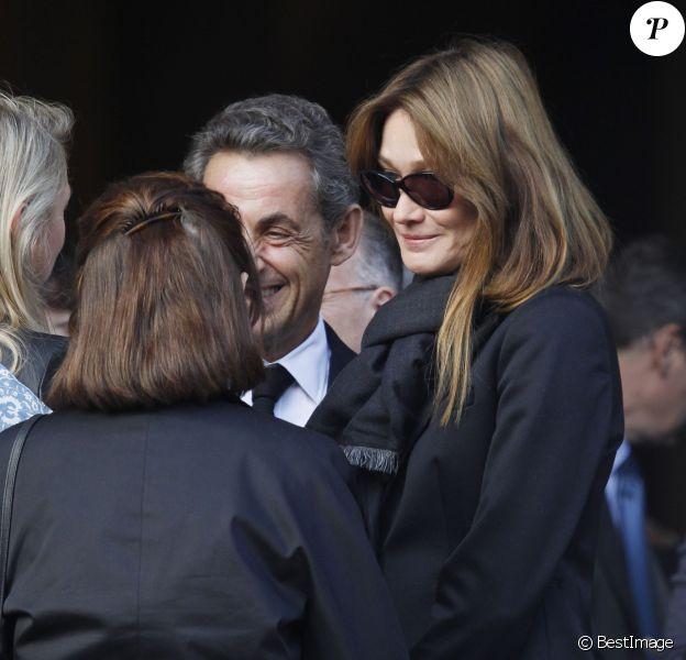 Nicolas Sarkozy et sa femme Carla Bruni Sarkozy - Cérémonie en l'honneur de l'ancien préfet Christian Frémont, qui fut le directeur de cabinet de Nicolas Sarkozy à l'Elysée, en l'église Saint-François-Xavier à Paris, le 24 septembre 2014.