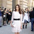 Emma Miller arrive au défilé Dior printemps/été 2015 le 26 septembre 2014