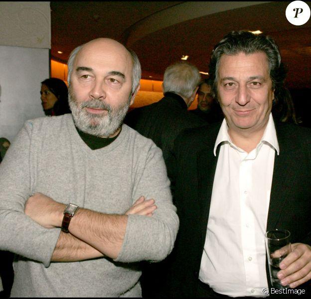 Gérard Jugnot et Christian Clavier lors de la projection du film Les Bronzés 3 à Paris le 18 janvier 2006