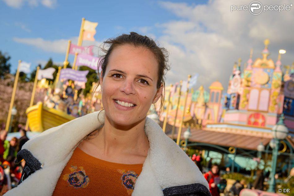 Laure Manaudou au parc Disneyland Paris, fête le 50e anniversaire de l'attraction It's a small world.