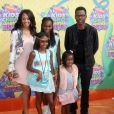 """Chris Rock, sa femme Malaak Compton-Rock et leurs filles Lola Simone et Savannah lors de la 27ème cérémonie annuelle des """"Kid's Choice Awards"""" à Los Angeles, le 29 mars 2014."""