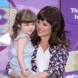 Tiffani Thiessen et sa fille Harper au Disney Store de Times Square à New York le 21 août 2013