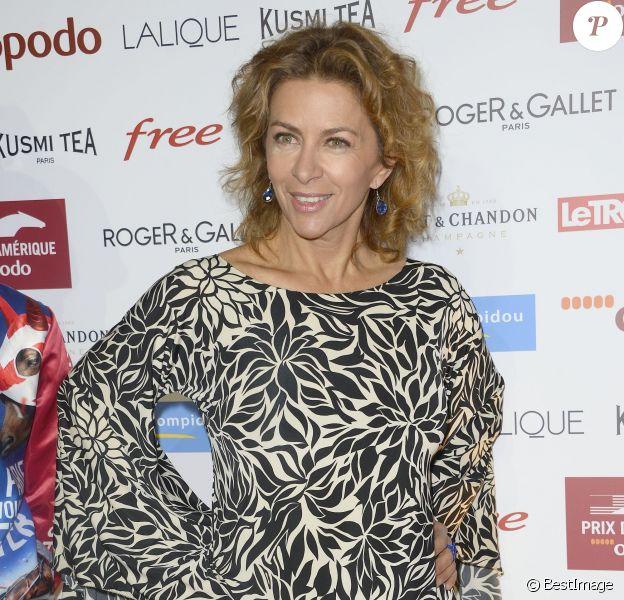 Corinne Touzet assiste à la soirée de Gala du Prix d'Amérique Opodo à la Maison de l'UNESCO à Paris le 24 janvier 2015.