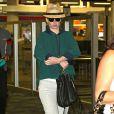 Exclusif - Iggy Azalea arrive à l'aéroport de Fort Lauderdale, le 21 décembre 2014.