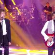 Alain Souchon et Laurent Voulzy sur la scène des 30e Victoires de la musique, au Zénith de Paris, le 13 février 2015.