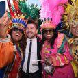"""Chris Marques - Première bataille de fleurs sur la Promenade des Anglais lors du 131ème carnaval de Nice """"Roi de la Musique"""", avec une partie des membres de """"Danse avec les stars"""", le 18 février 2015."""