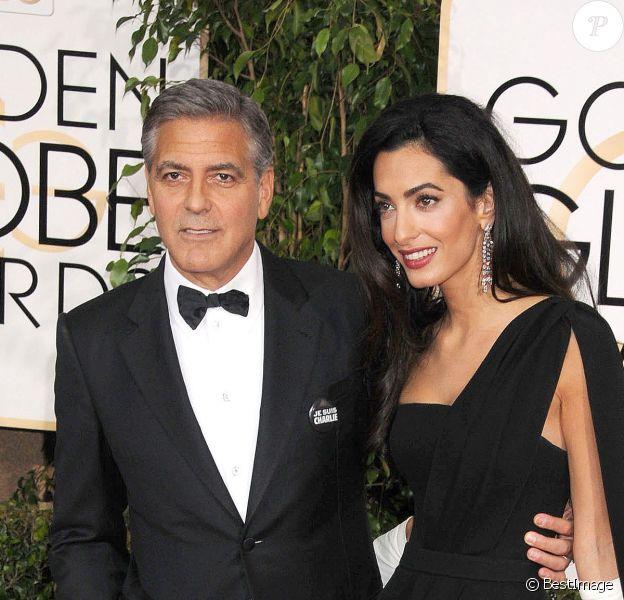 George Clooney et sa femme Amal Alamuddin (robe Dior Haute Couture) - 72e cérémonie des Golden Globe Awards à Beverly Hills, le 11 janvier 2015.