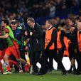 L'équipe du PSG célèbre la qualification pour le quart de finale de la Ligue des champions après son nul 2-2 face à Chelsea, le 11 mars 2015 à Londres