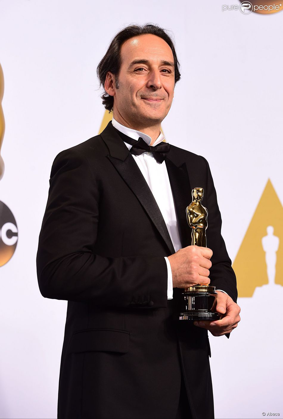 Alexandre Desplat with the Original Score Award for 'The Grand Budapest Hotel', in the press room of the 87th Academy Awards held at the Dolby Theatre in Hollywood, Los Angeles, CA, USA, February 22, 2015. Photo by Ian West/PA Wire/ABACAPRESS.COM23/02/2015 - Los Angeles
