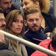 M. Pokora et Scarlett Baya au Stade de France le 26 mars 2015, pour le match amical France-Brésil.