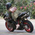 """Exclusif - Prix Spécial - Justin Bieber fait de la moto à Los Angeles, le 17 mars 2015. Le chanteur a customisé sa moto Ducati avec ses initiales """"JB"""". Escorté par ses gardes du corps, Justin a suivi la voiture de Corey Gamble (ex de Kris Jenner)"""