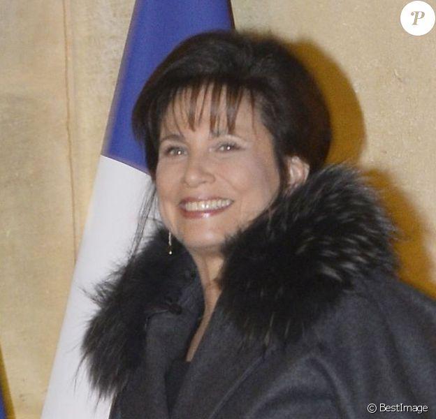 Anne Sinclair tout sourire et Pierre Nora arrivent au Palais de l'Elysée à Paris le 9 decembre 2013. L'historien a été élevé, par François Hollande, au grade de grand officier de la Légion d'honneur.