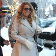 Mariah Carey fait du shopping en bottines Louboutin dans les rues enneigées de Aspen, le 23 décembre 2014