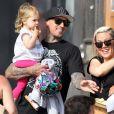 La chanteuse Pink, son mari Carey Hart et leur fille Willow s'amusent en famille a Venice Beach, le 9 Juin 2013. Ils ont fait du vélo, puis ont emmené la petite Willow faire de la balançoire.