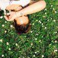 Pauline Ducruet, photo Instagram du 3 mai 2014 avec son tatouage de fleur réalisé en février de la même année