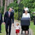 Le prince William, Catherine, la duchesse de Cambridge, leur fils le prince George de Cambridge et leur fille la princesse Charlotte de Cambridge lors du baptême de la princesse Charlotte en l'église Saint Mary Magdalene de Sandringham, le 5 juillet 2015