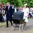 Le prince William, Kate Middleton, la duchesse de Cambridge, leur fils le prince George de Cambridge et leur fille la princesse Charlotte de Cambridge lors du baptême de la princesse Charlotte en l'église Saint Mary Magdalene de Sandringham, le 5 juillet 2015