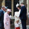 Le prince William, Kate Middleton, la duchesse de Cambridge, leur fils le prince George de Cambridge, la princesse Charlotte de Cambridge, le prince Philip duc d'Edimbourg, la reine Elisabeth II et Camilla Parker Bowles, la duchesse de Cornouailles lors du baptême de la princesse Charlotte en l'église Saint Mary Magdalene de Sandringham, le 5 juillet 2015