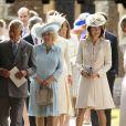 Le prince Charles, Camilla Parker Bowles, la duchesse de Cornouailles, Carole Middleton lors du baptême de la princesse Charlotte en l'église Saint Mary Magdalene de Sandringham, le 5 juillet 2015