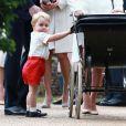 Le prince George de Cambridge lors du baptême de la princesse Charlotte en l'église Saint Mary Magdalene de Sandringham, le 5 juillet 2015