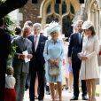 Michael Middleton, James Middleton et Carole Middleton, Camilla Parker Bowles, la duchesse de Cornouailles et le prince Charles lors du baptême de la princesse Charlotte en l'église Saint Mary Magdalene de Sandringham, le 5 juillet 2015