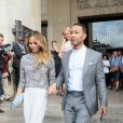 John Legend et Chrissy Teigen quittent le Théâtre National de Chaillot à l'issue du défilé Armani Privé (collection haute couture automne-hiver 2015/2016). Paris, le 7 juillet 2015.