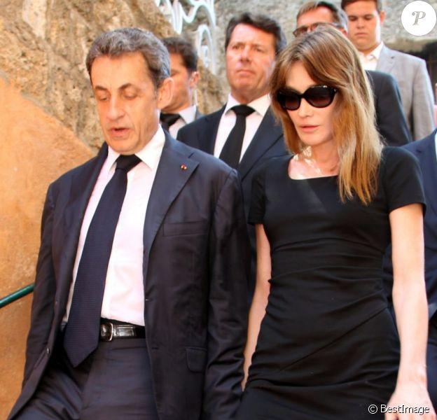 Nicolas Sarkozy et sa femme Carla Bruni-Sarkozy aux obsèques de Charles Pasqua en la cathédrale Notre-Dame du Puy à Grasse, le 7 juillet 2015.