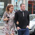 Wayne et Coleen Rooney dans les rues de Manchester, le 20 août 2013