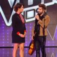 L'animatrice Karine Ferri, enceinte et radieuse, lors de la finale de  The Voice Kids 2 , vendredi 23 octobre sur TF1.