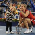 Kim Clijsters et sa fille Jada après la finale de l'US Open à Flushing Meadows, le 13 septembre 2009