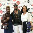 """Guest, le rappeur Capuccino et Yvette Tai-Coquillay (fondatrice Labo International) - Photocall """"10 ans Labo International - Afro Fashion Remix"""" à Paris Salon multi-ethnique""""LE LABO INTERNATIONAL"""" qui a eu lieu le 11 et 12 juin 2016 à l'espace des Blancs Manteaux dans le Marais. Des défilés, des shows, de nombreux happenings, des conférences ont rythmés le week-end sous le signe de la Mode et du Glamour."""
