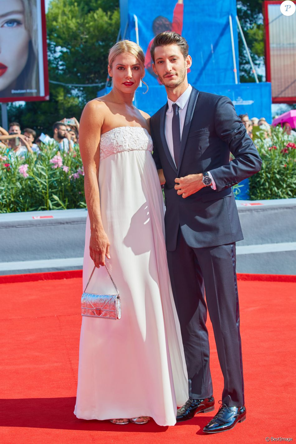 Natasha Andrews (en Dior et Cartier) et son compagnon Pierre Niney ( en Dior et Montblanc) lors de la première du film ''Frantz'' pendant le 73ème Festival du Film de Venise, la Mostra, le 3 septembre 2016