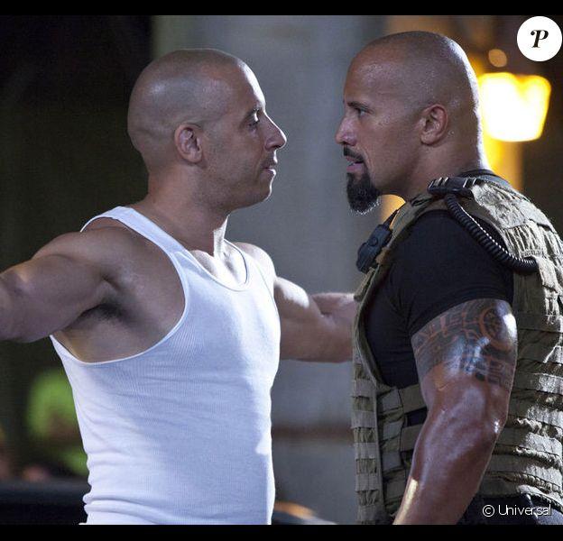 Vin Diesel et Dwayne Johnson, les deux gros bras de la saga Fast & Furious.