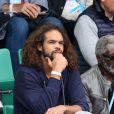 Joakim Noah et son grand-pére Zacharie dans les tribunes des internationaux de France de Roland Garros à Paris le 4 juin 2016. © Moreau - Jacovides / Bestimage