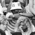 ARCHIVES - ZACHARIE NOAH ASSISTE A LA FINALE DU TOURNOI DE ROLAND GARROS 1983 NOAH - WILANDER , EN BAS JEAN LOUIS AUBERT ET SA FEMME 06/06/1983 - Paris