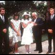 La princesse Caroline de Monaco en famille avec sa soeur Stéphanie, son père Rainier et son mari Stefano, en 1984 lors du baptême de son premier enfant, Andrea Casiraghi.