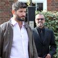 George Michael quitte son domicile avec son petit-ami Fadi Fawaz à Londres le 14 mars 2012