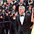 """George Clooney et sa femme Amal Alamuddin Clooney (bijoux Cartier) - Montée des marches du film """"Money Monster"""" lors du 69e Festival International du Film de Cannes. Le 12 mai 2016. © Giancarlo Gorassini/Bestimage"""