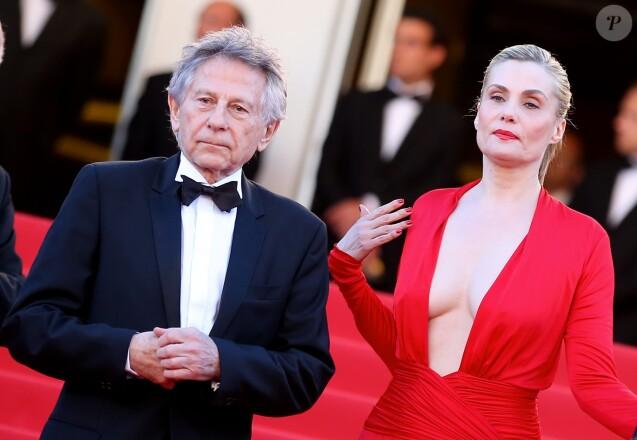 Roman Polanski et sa femme Emmanuelle Seigner lors de la montée des marches pour la projection de La Venus à la fourrure au 66e Festival de Cannes, en mai 2013