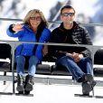 """Emmanuel Macron, candidat à l'élection présidentielle pour son mouvement """"En Marche!"""" et sa femme Brigitte Macron (Trogneux) dans la station de ski Grand Tourmalet (La Mongie / Barèges), France, le 12 avril 2017. Ils empruntent un télésiège pour se rendre dans le restauant d'altitude pour le déjeuner. C'est un retour au source pour le candidat à la présidentielle. C'est en effet là que dans sa jeunesse, il a appris à marcher et à skier. A la fin d'un repas partagé avec ses proches, il n'a pas failli à la tradition en entonnant l'un des hymnes pyrénéens, """" Montagne Pyrénées"""". © Dominique Jacovides/Bestimage French presidential election candidate for the En Marche ! movement Emmanuel Macron and his wife Brigitte Trogneux take a chairlift for a lunch break during a campaign visit at Ski resort Grand Tourmalet (La Mongie / Barèges), France, on April 12, 2017.12/04/2017 - Grand Tourmalet"""