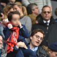 Jean Sarkozy et son fils Solal - Célébrités dans les tribunes du parc des princes lors du match de football de ligue 1 PSG-Bastia le 6 mai 2017.