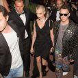 Cara Delevingne, Jeremy Scott et Lily Donaldson se rendent à la soirée d'ouverture de la plage Magnum Cannes. Cannes, le 18 mai 2017.