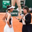 Marion Bartoli interviewe Garbine Mugura à Roland-Garros le 2 juin 2017.