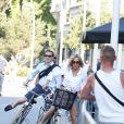 La première dame Brigitte Macron (Trogneux) part en vélo à la plage avec sa fille Tiphaine Auzière, son compagnon Antoine et leurs enfants Elise et Aurèle au Touquet, le 17 juin 2017 © Dominique Jacovides/Sébastien Valiela/Bestimage