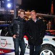 Jean-Pierre Pernaut et son fils Olivier posent devant leur Citroen C4 lors de la conference de presse de la 25eme edition du Trophee Andros a Paris le 27 novembre 2013.