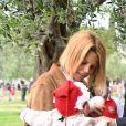 Exclusif - Christian Estrosi, le maire de Nice, et sa femme Laura Tenoudji avec leur fille Bianca - Christian Estrosi (le maire de Nice) et sa femme Laura Tenoudji ont fêté en famille le 1er mai dans les jardins de Cimiez pour la Fête des Mai à Nice, le 1er mai 2018. © Bruno Bebert/Bestimage