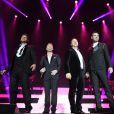 Keith Duffy, Ronan Keating, Mikey Graham, Shane Lynch - Le groupe Boyzone en concert au Wembley Arena a Londres, le 21 decembre 2013.